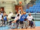 Nagwa (in white) compete against Public Prosecution in the wheelchair basketball final at the Nas Sports Complex.