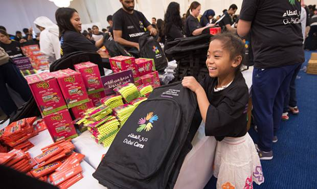 Dubai volunteers pack school kits for Syria