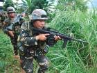 File photo: Philippine troops patrol a forested area near Marawi on the southern island of Mindanao.