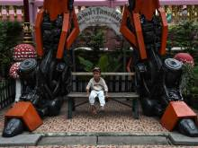 Superheroes stand guard at Thai temple