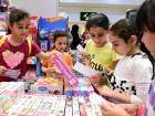 Syrian refugee children pick whatever they want at Dubai Outlet Mall