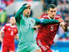 Portugal's Cristiano Ronaldo is challenged by Russia's Viktor Vasin during their Confederations Cup Group A match at the Spartak Stadium in Moscow on Wednesday.