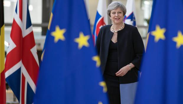 UK's May says EU citizens can stay post-Brexit