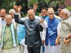 Senior BJP leader M.M. Joshi, NDA presidential candidate Ram Nath Kovind (second left), senior BJP leader L.K.Advani and Prime Minister Narendra Modi hold hands as they walk to Parliament House yesterday to file Kovind's nomination papers.