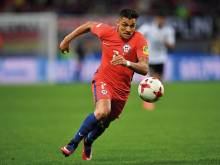 History-making Sanchez blanks Arsenal talk