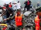 Chinese military police and rescue workers are seen at the site of a landslide in Xinmo village