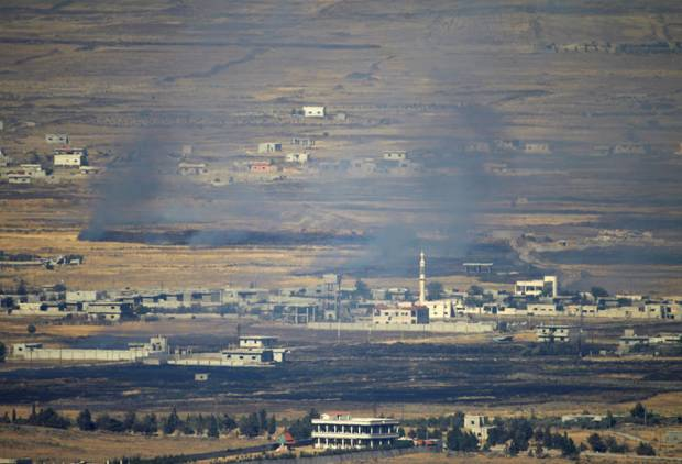 Israel hits Syrian targets after stray fire
