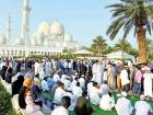 Worshipers leaving after they performed Eid prayer at the garden of Shaikh Zayed Grand Mosque.