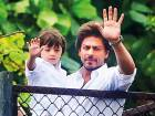Shah Rukh and son AbRam greet the actor's fans on Monday.