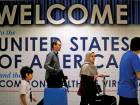 International passengers arrive at Washington Dulles International Airport after the U.S. Supreme Court granted parts of the Trump administration's emergency request to put its travel ban into effect later in the week pending further judicial review, in Dulles, Virginia, U.S.
