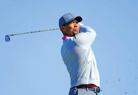Woods' treatment over, sets no dates for return