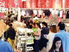 People taking advantage of the discounts and promotions at stores.
