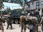 In this May 30, 2017 photo, Philippines government troops prepare to head to the frontline as fighting with Muslim militants in Marawi city continued in southern Philippines.