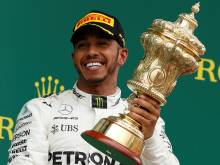 Lewis reigns at Silverstone to cut Vettel lead