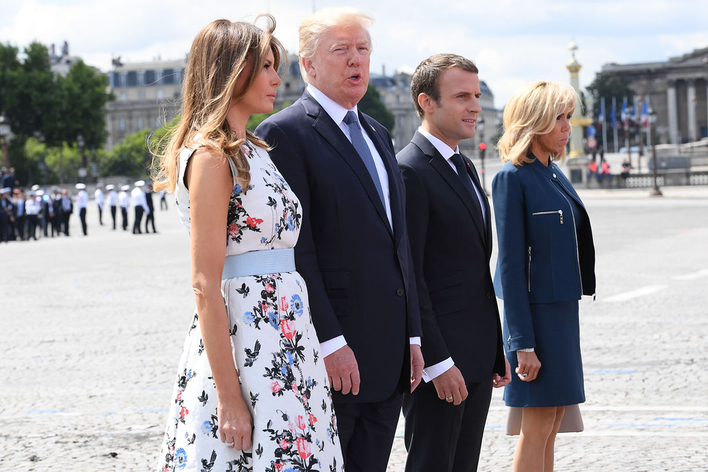 French President Emmanuel Macron (2nd R) and his wife Brigitte Macron (R) stand with US President Do
