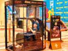 A man playing video games in a booth at a shopping mall in Shanghai, China.