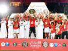 Al Jazira players and officials celebrate after winning the Arabian Gulf League last season. Al Jazira and Arabian Gulf Cup winners Al Ahli will each be assigned a group of six as top seeds.