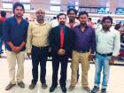 Social worker Girish Pant (in red tie) sees off five crewmembers of the vessel Abdul Razak who returned to India onTuesday night after receiving their pending salaries.