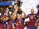 United States forward Clint Dempsey (28) hoists the trophy after the finals of the CONCACAF Gold Cup against Jamaica at Levi's Stadium. The United States defeated Jamaica 2-1