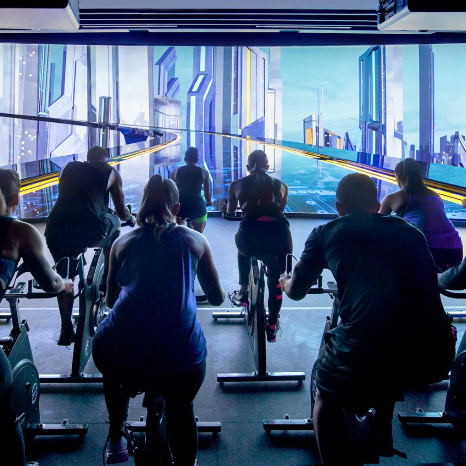 Widescreen imagery is incorporated in this cycle class for an immersive fitness experience