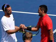 Injury-hit Kyrgios wins first round in Montreal