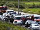 French police and emergency workers intervene on the site after the police arrested a suspect on the A16 motorway, near Marquise, northern France, on August 9, 2017.
