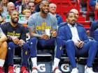 Cleveland Cavaliers' Kyrie Irving (left), LeBron James (centre) and J.R. Smith (right) watching from the bench during the first half of the NBA game against the Miami Heat last season.