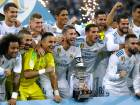 Real Madrid's players celebrate with their trophy after winning the Spanish Super Cup against Barcelona at the Santiago Bernabeu Stadium in Madrid, Thursday, August 17, 2017.