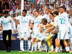 Cristiano Ronaldo (left) shares a lighter moment with his Real Madrid teammates as they celebrate their win in the second leg of the Spanish Super Cup against Barcelona at the Santiago Bernabeu stadium in Madrid.
