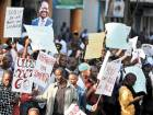 Supporters of Kenya's embattled opposition leader Raila Odinga wave placards and shout slogans as they demonstrate outsideThe Supreme Court in Nairobi on Friday. Odinga claims that election electronic results were hacked.