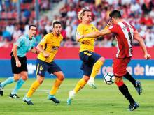 Atletico defy Griezmann red card for a draw