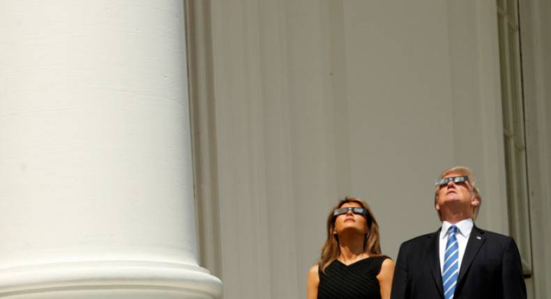U.S. President Donald Trump and Melania Trump watch the solar eclipse from the White House in Washington, U.S., August 21, 2017.