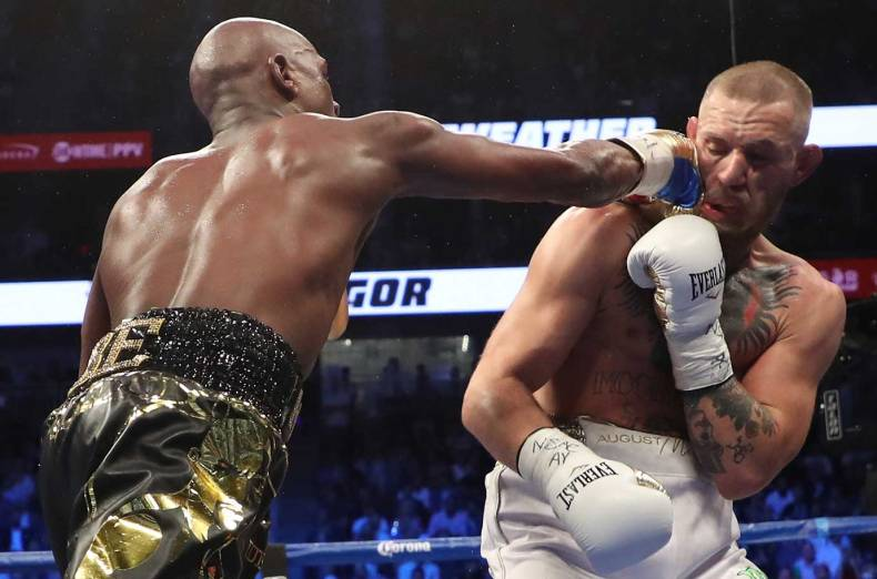 floyd-mayweather-jr-throws-a-punch-at-conor-mcgregor-during-their-super-welterweight-boxing-match