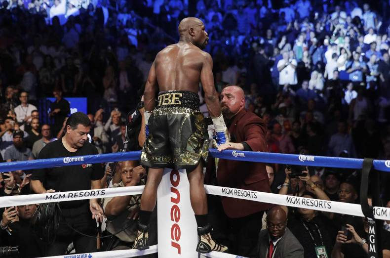 floyd-mayweather-jr-celebrates-after-defeating-conor-mcgregor-in-a-super-welterweight-boxing-match