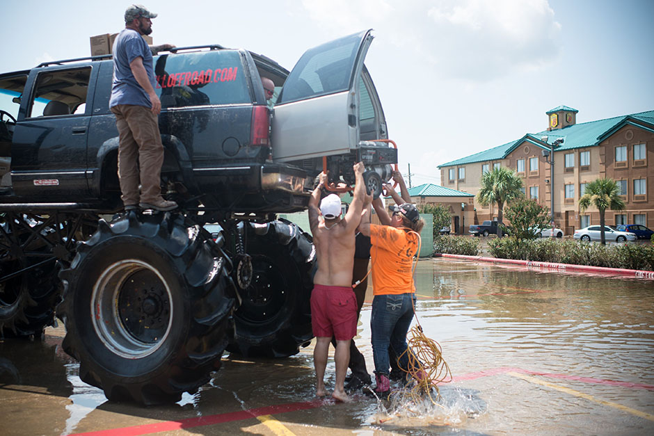 Old Habits, the monster truck, helps residents carry a generator