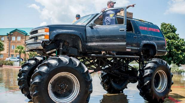 Old Habits, the monster truck, helps rescue residents through floods in Port Arthur, Texas