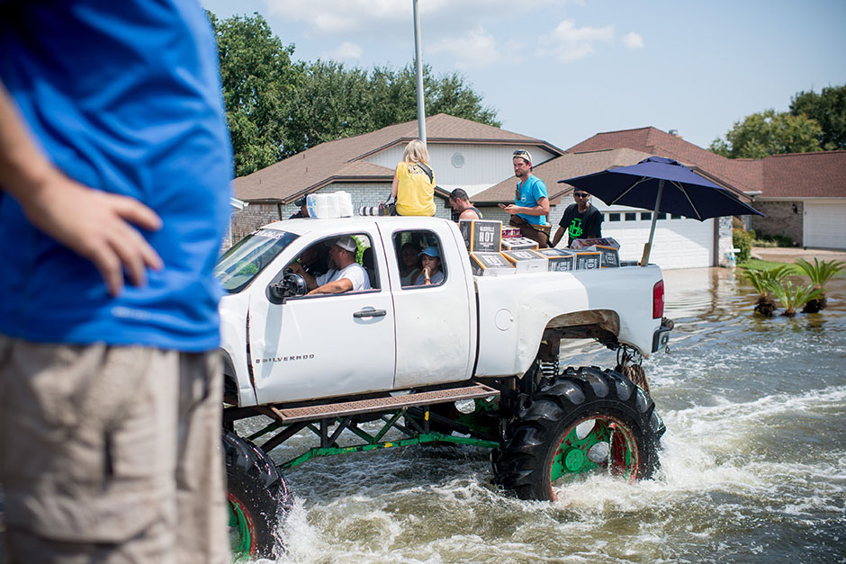 Monster Truck rescue teams help residents in flooded neighborhoods in Port Arthur, Texas