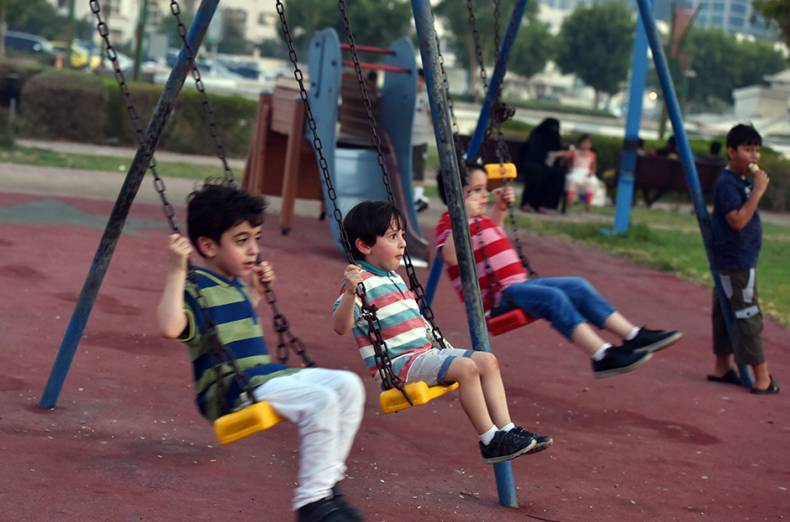 children-play-at-a-park-in-abu-dhabi-corniche