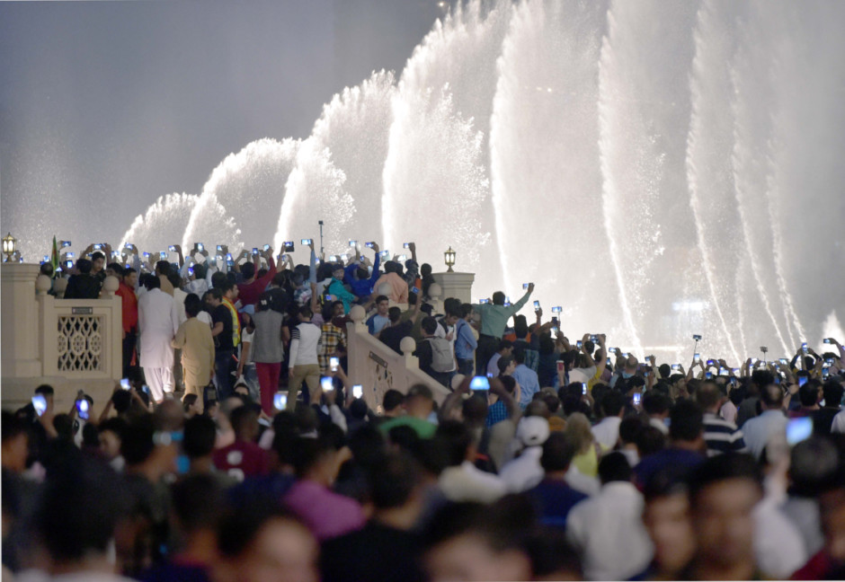 People gather at Dubai Mall to watch the musical fountain