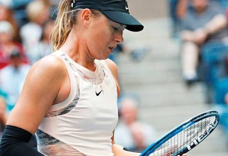 Sharapova back in business, on and off court