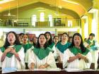 The choir sings at a mass held by Bruce Aitken, an ex-inmate, in Hong Kong, on August 13. Aitken isalso responsible for the popular Hour of Love show.