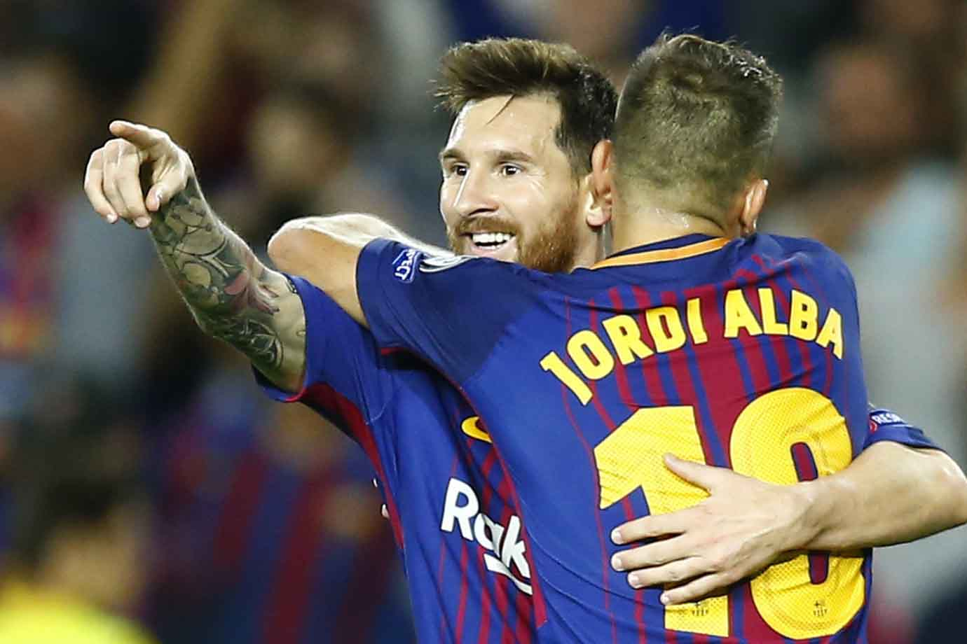 Barcelona's Lionel Messi celebrates scoring his side's third.