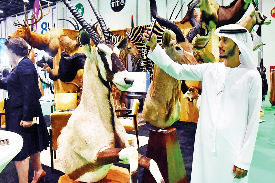 An Emirati takes a selfie with stuffed animals