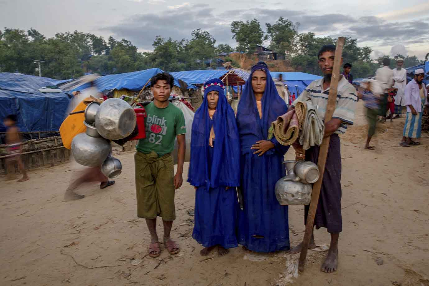 A Rohingya Muslim family, who crossed over from Myanmar into Bangladesh, poses for a picture as they