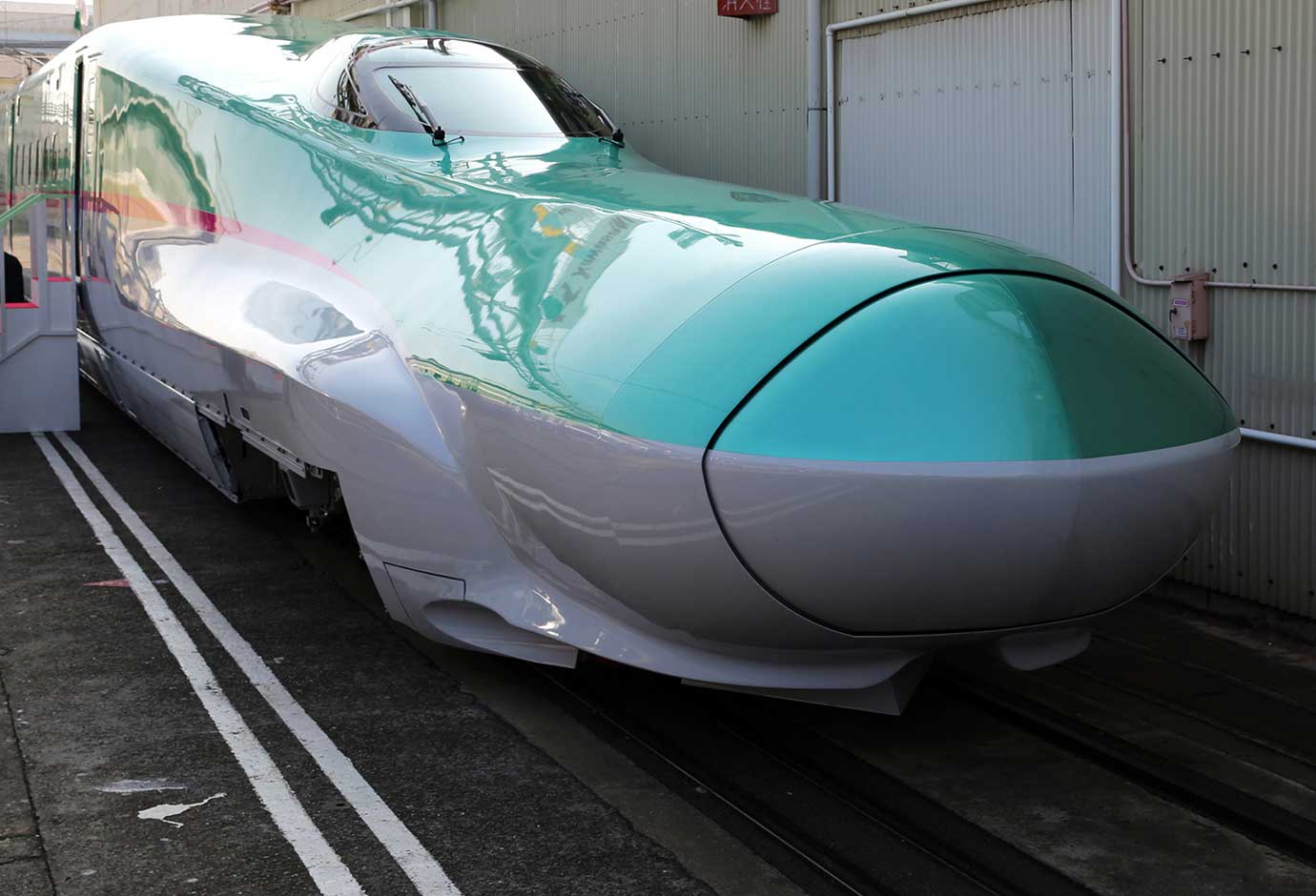 An E5 series Shinkansen bullet train sits parked on a track at Kawasaki Heavy Industries's plant in