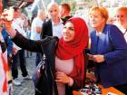 German Chancellor Angela Merkel, a top candidate of the Christian Democratic Union Party for the upcoming general elections, poses for a selfie during an election rally in Stralsund. Germany has experienced a surge of racist and incendiary speech online.
