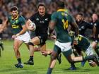 New Zealand's Anton Lienert-Brown runs through South African defence.