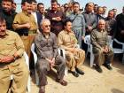 Kirkuk's provincial governor Najim Al Deen Karim (second from left), who was sacked by the Iraqi parliament last week, attends a rally in Kirkuk in support of the Kurdish referendum.