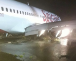 Jet slides off Mumbai runway, stuck in mud