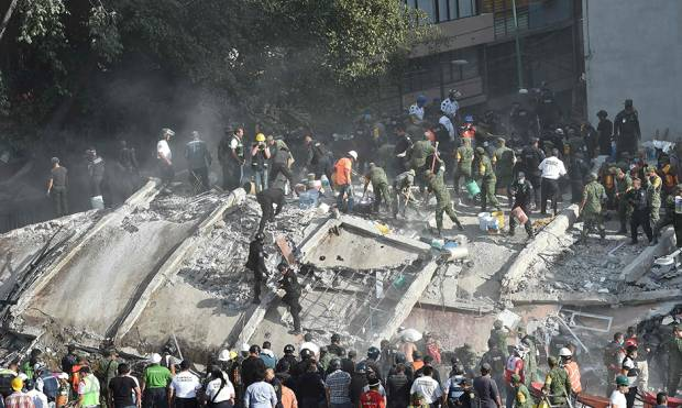 Rescue teams look for people trapped in the rubble after an earthquake in Mexico City